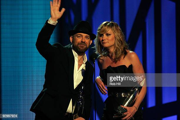 Musicians Jennifer Nettles and Kristian Bush of Sugarland perform onstage during the 43rd Annual CMA Awards at the Sommet Center on November 11, 2009...