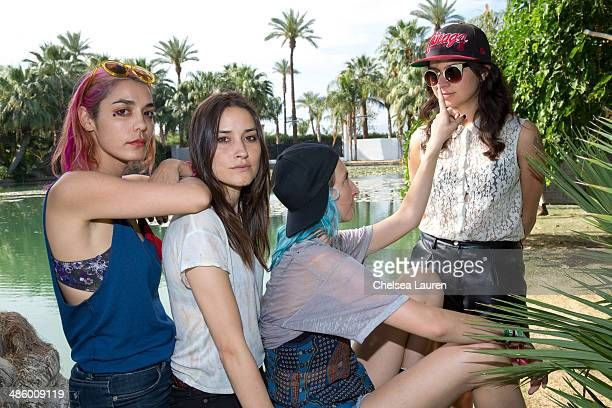 Musicians Jenny Lee Lindberg Theresa Wayman Emily Kokal and Stella Mozgawa of Warpaint pose backstage during the Coachella valley music and arts...