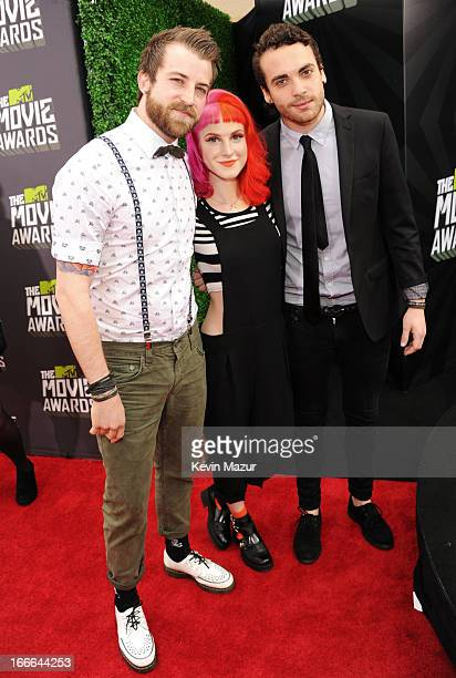 Musicians Jeremy Davis, Hayley Williams and Taylor York of Paramore arrive at the 2013 MTV Movie Awards at Sony Pictures Studios on April 14, 2013 in...