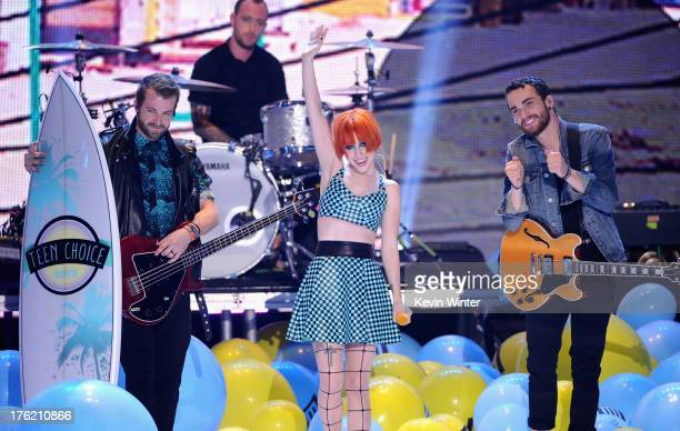 Musicians Jeremy Davis, Hayley Williams and Taylor York of Paramore, winners of Choice Rock Group, speak onstage during the Teen Choice Awards 2013...