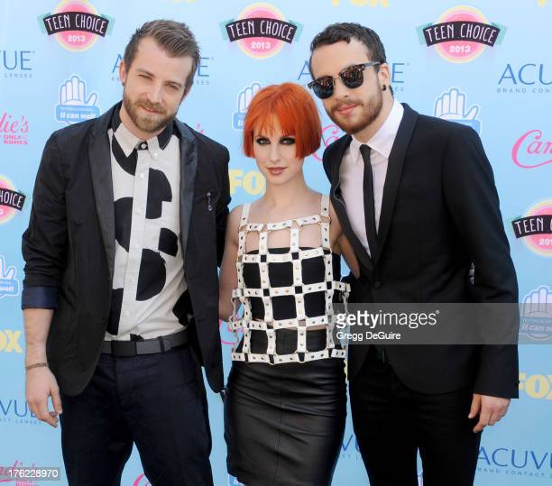 Musicians Jeremy Davis Hayley Williams and Taylor York of Paramore arrive at the 2013 Teen Choice Awards at Gibson Amphitheatre on August 11 2013 in...