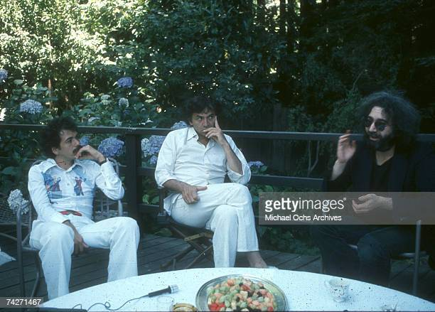 Musicians Jerry Garcia and Carlos Santana with promoter Bill Graham pose for a portrait in 1976 in Mill Valley California