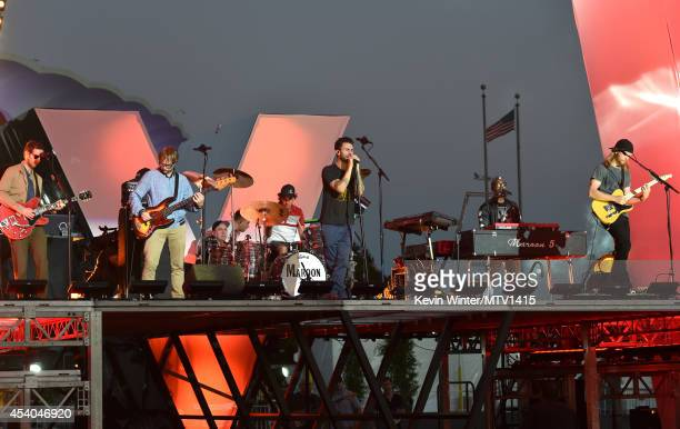 Musicians Jesse Carmichael Mickey Madden Matt Flynn Adam Levine PJ Morton and James Valentine of the band Maroon 5 perform onstage during rehearsals...