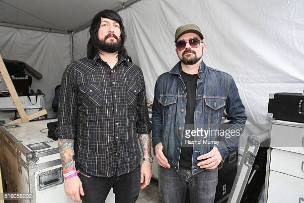 Musicians Jesse F Keeler and AlP of MSTRKRFT pose backstage during the PANDORA Discovery Den SXSW on March 16 2016 in Austin Texas