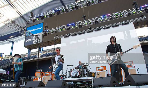 Musicians Jesse Hughes Dave Catching Matt McJunkins Eden Galindo and Jorma Vik of Eagles of Death Metal perform at Children's Mercy Park on July 17...