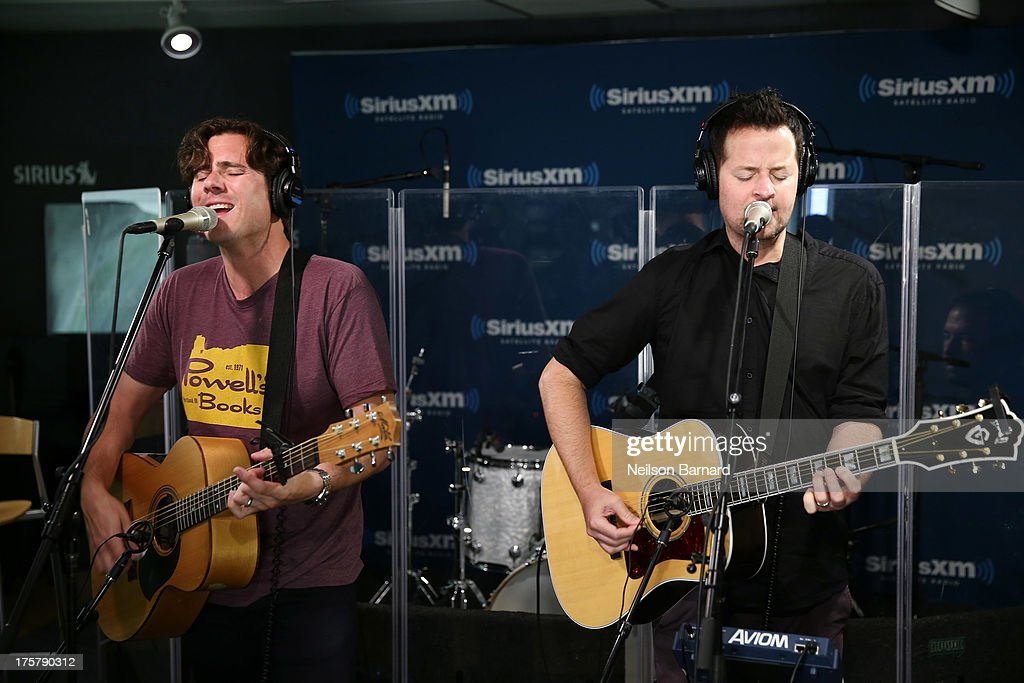 Musicians Jim Adkins, Rick Burch and Zach Lind of the band Jimmy Eat World visit SiriusXM Studios on August 8, 2013 in New York City.