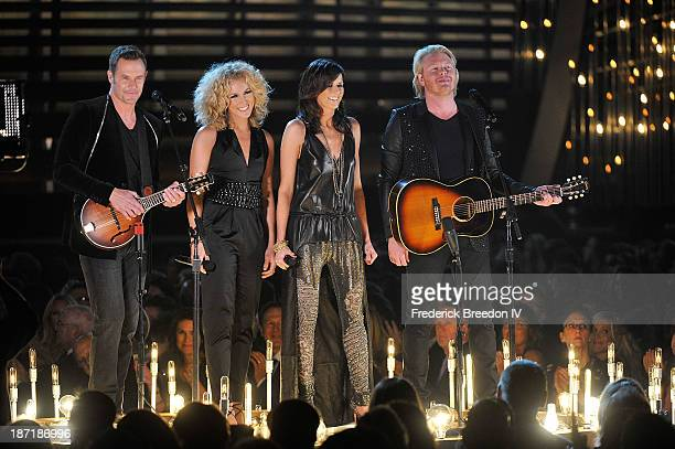 Musicians Jimi Westbrook Kimberly Schlapman Karen Fairchild and Philip Sweet of the band Little Big Town performs during the 47th annual CMA awards...