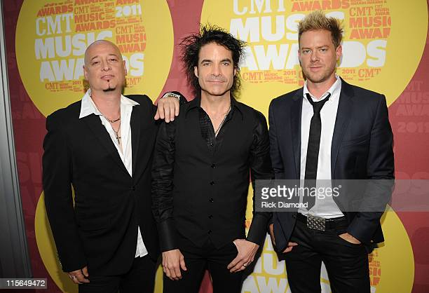 Musicians Jimmy Stafford Patrick Monahan and Scott Underwood of Train attend the 2011 CMT Music Awards at the Bridgestone Arena on June 8 2011 in...
