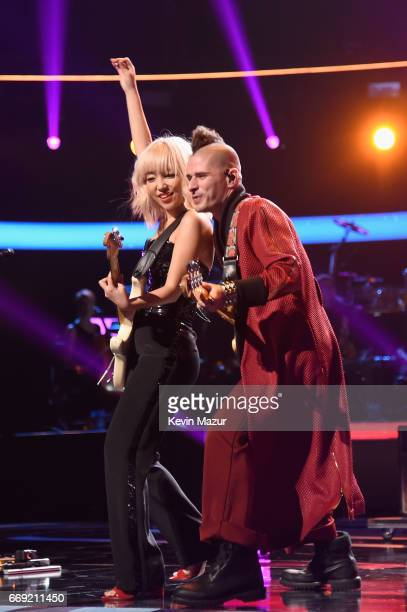 Musicians JinJoo Lee and Cole Whittle of musical group DNCE perform onstage during 'Stayin' Alive A GRAMMY Salute To The Music Of The Bee Gees' on...