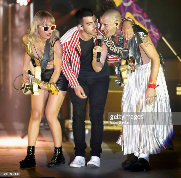 Musicians JinJoo Lee Joe Jonas and Cole Whittle of DNCE perform on the second night of CBS RADIO's 'SPF' concert at The Boulevard Pool at The...