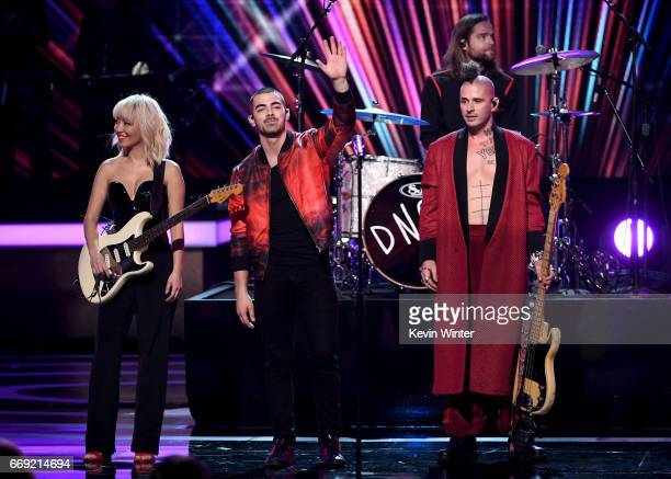 Musicians JinJoo Lee Joe Jonas Jack Lawless and Cole Whittle of DNCE perform onstage during 'Stayin' Alive A GRAMMY Salute To The Music Of The Bee...