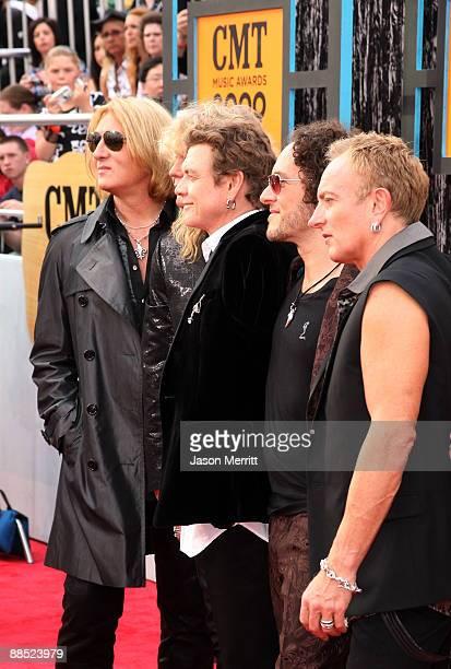Musicians Joe Elliott, Rick Savage, Rick Allen, Phil Collen and Vivian Campbell of Def Leppard attend the 2009 CMT Music Awards at the Sommet Center...