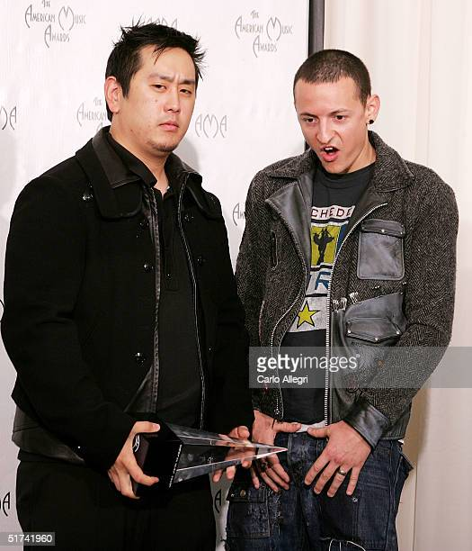 Musicians Joe Hahn and Chester Bennington of Linkin Park pose with theor award in the press room before being removed by security at the 32nd Annual...