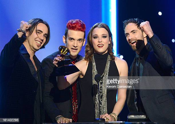 Musicians Joe Hottinger Arejay Hale Lzzy Hale and Joe Hottinger of the band Halestorm accept the Best Hard Rock/Metal Performance Award for Love...