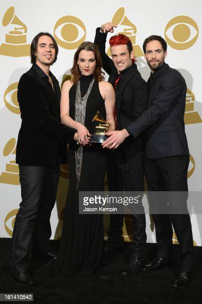 Musicians Joe Hottinger Lzzy Hale Arejay Hale and Josh Smith of the band Halestorm pose in the press room during the 55th Annual GRAMMY Awards at...