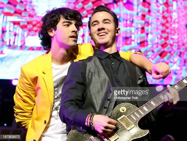 Musicians Joe Jonas and Kevin Jonas of the Jonas Brothers performs onstage during KIIS FM's 2012 Jingle Ball at Nokia Theatre LA Live on December 1...