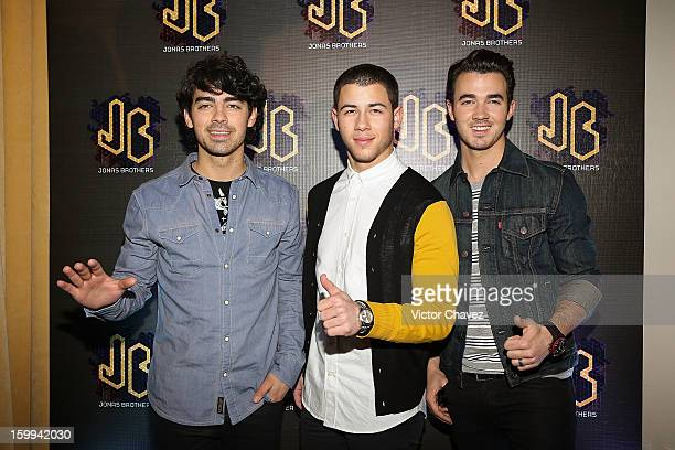 Musicians Joe Jonas Nick Jonas and Kevin Jonas of the Jonas Brothers attend a press conference at W Hotel Mexico City on January 23 2013 in Mexico...