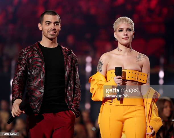 Musicians Joe Jonas of music group DNCE and Halsey speak onstage at the 2017 iHeartRadio Music Awards which broadcast live on Turner's TBS TNT and...