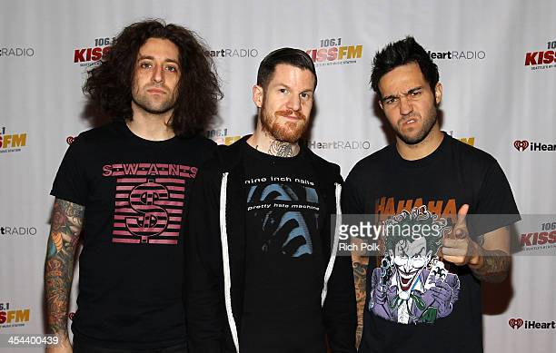 Musicians Joe Trohman Andy Hurley and Pete Wentz of Fall Out Boy attend 1061 KISS FM's Jingle Ball 2013 at Comcast Arena at Everett on December 8...