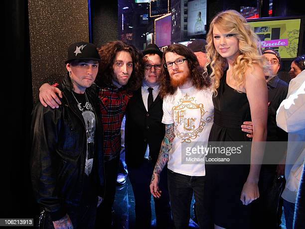 Musicians Joe Trohman , Patrick Stump and Andy Hurley of Fall Out Boy pose with musician Benji Madden of Good Charlotte and musician Taylor Swift...