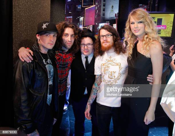 Musicians Joe Trohman Patrick Stump and Andy Hurley of Fall Out Boy pose with musician Benji Madden of Good Charlotte and musician Taylor Swift...