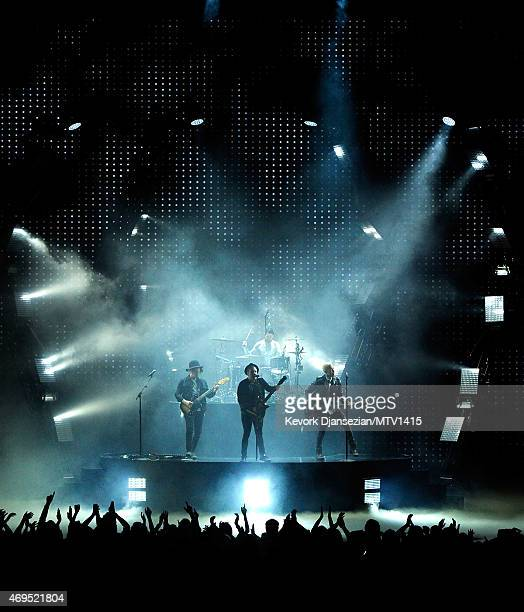 Musicians Joe Trohman Patrick Stump Andy Hurley and Pete Wentz of Fall Out Boy perform onstage during The 2015 MTV Movie Awards at Nokia Theatre LA...