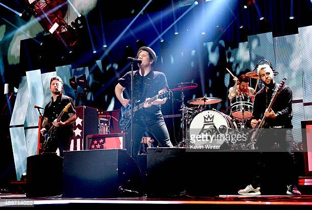 Musicians Joe Trohman Patrick Stump Andy Hurley and Pete Wentz of Fall Out Boy perform at the 2015 iHeartRadio Music Festival at the MGM Grand Garden...