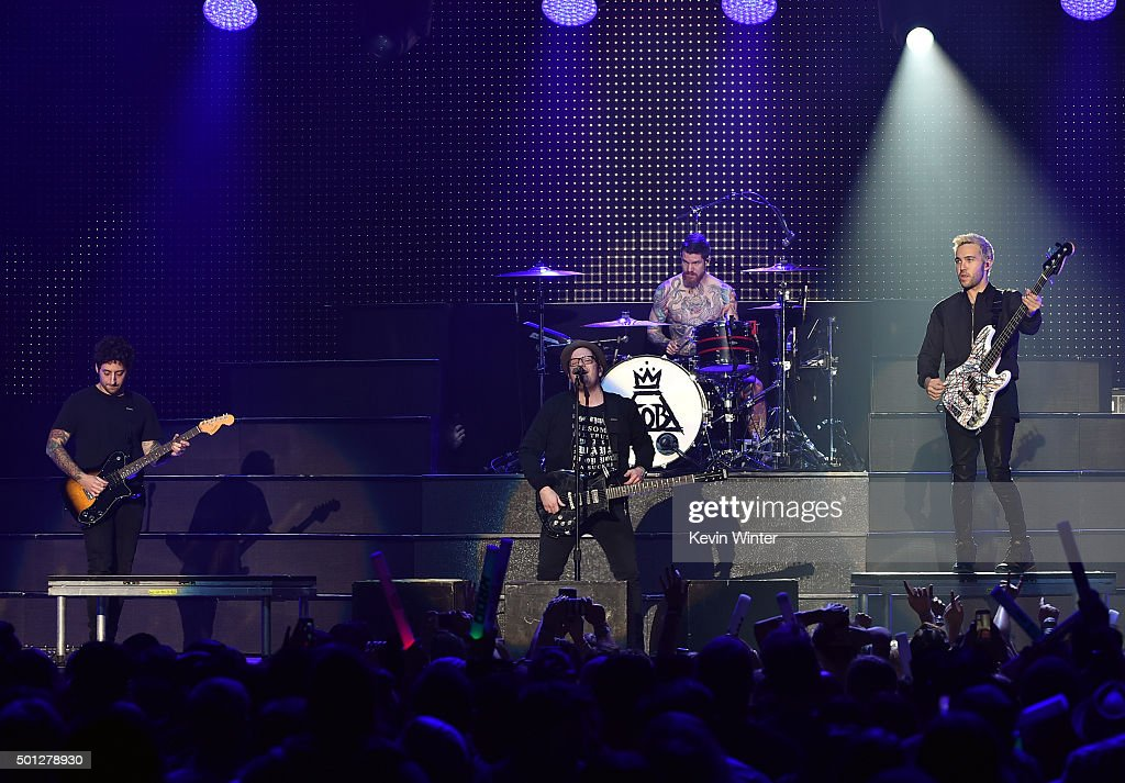 Musicians Joe Trohman, Patrick Stump, Andy Hurley and Pete Wentz of Fall Out Boy perform onstage during 106.7 KROQ Almost Acoustic Christmas 2015 at The Forum on December 13, 2015 in Los Angeles, California.