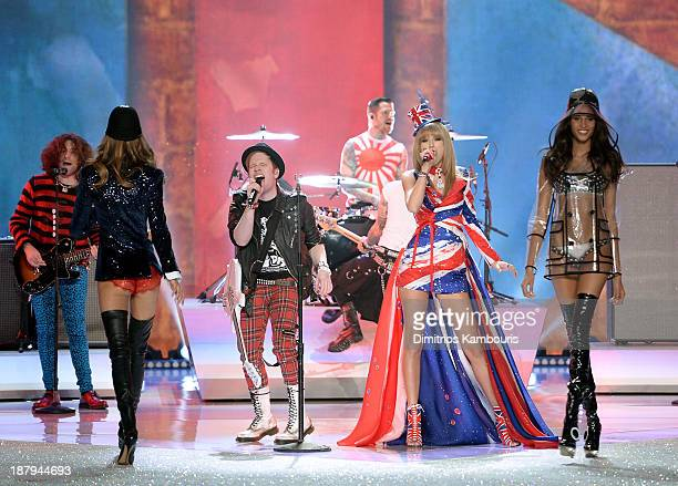 Musicians Joe Trohman Patrick Stump Andy Hurley and Pete Wentz of the band Fall Out Boy and Taylor Swift perform and models Kasi Struss and Cindy...
