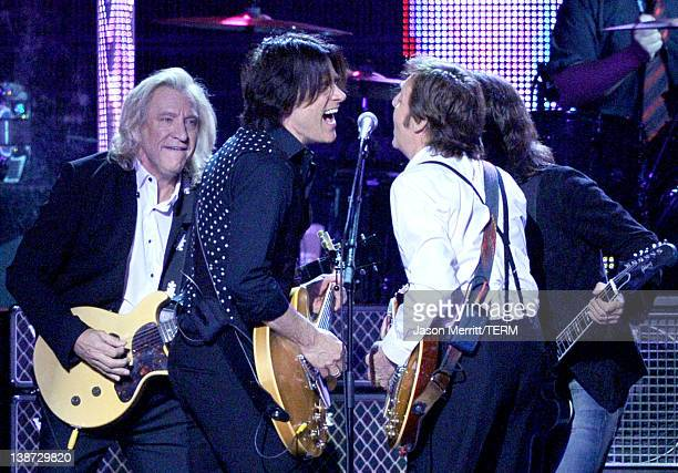 Musicians Joe Walsh Rusty Anderson Honoree Sir Paul McCartney and Dave Grohl of the Foo Fighters perform onstage at the 2012 MusiCares Person of the...