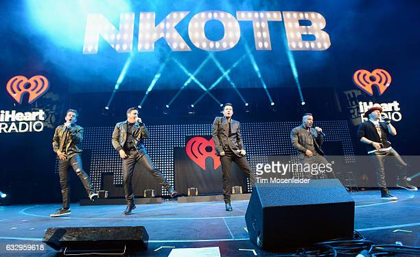 Musicians Joey McIntyre Jonathan Knight Jordan Knight Danny Wood and Donnie Wahlberg of New Kids on the Block perform on stage during the iHeart80s...