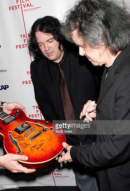 Musicians John Auer and Donovan sign a guitar at the ASCAP Tribeca Music Lounge held at the Canal Room during the 2007 Tribeca Film Festival on May 3...