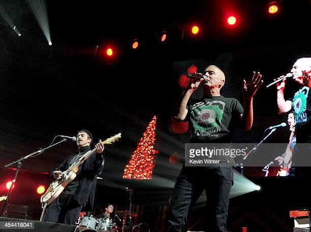 Musicians John Baldwin Gourley of Portugal. The Man and singer Curt Smith perform onstage during The 24th Annual KROQ Almost Acoustic Christmas at...