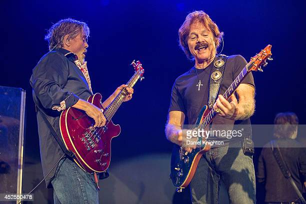 Musicians John Cowan and Tom Johnston perform on stage with The Doobie Brothers on July 22 2014 in San Diego California