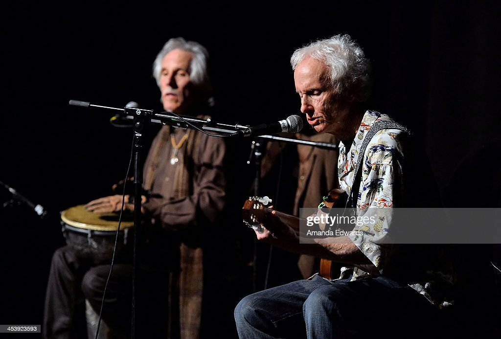 Musicians John Densmore (L) and Robby Krieger perform onstage at the Film Independent at LACMA Presents An Evening With The Doors event at Bing Theatre At LACMA on December 5, 2013 in Los Angeles, California.