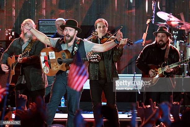 Musicians John Driskell Hopkins Zac Brown Jimmy De Martini and Coy Bowles of Zac Brown Band perform onstage during 'The Concert For Valor' at The...