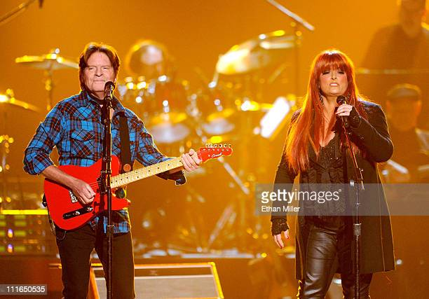 Musicians John Fogerty and Wynonna Judd perform onstage during ACM Presents Girls' Night Out Superstar Women of Country concert held at the MGM Grand...