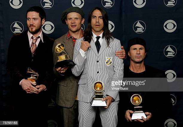 Musicians John Frusciante, Flea, Anthony Kiedis and Chad Smith of Red Hot Chili Peppers pose with their Grammys for Best rock Performance By a Duo or...