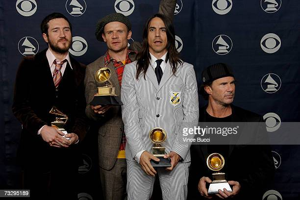 Musicians John Frusciante Flea Anthony Kiedis and Chad Smith of Red Hot Chili Peppers pose with their Grammys for Best rock Performance By a Duo or...