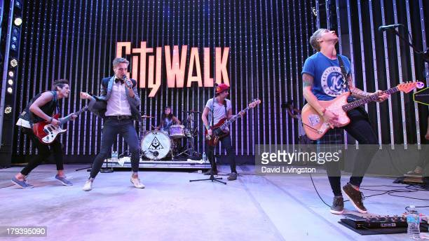 Musicians John Gomez Brian Dales Jess Bowen Stephen Gomez and Josh Montgomery of The Summer Set perform on stage at Universal CityWalk's Music...