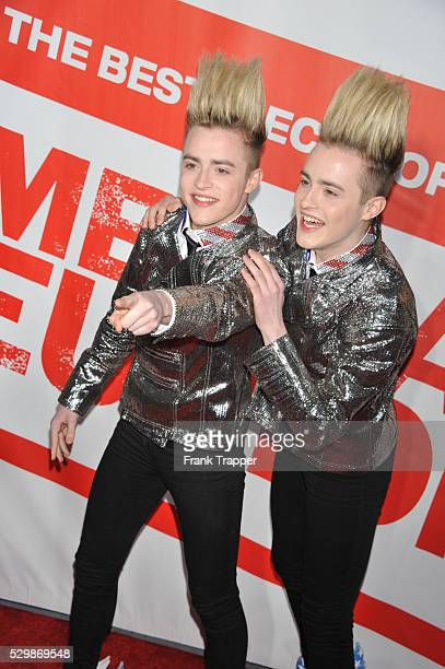 Musicians John Grimes and Edward Grimes arrive at the premiere of American Reunion held at Grauman's Chinese Theater in Hollywood