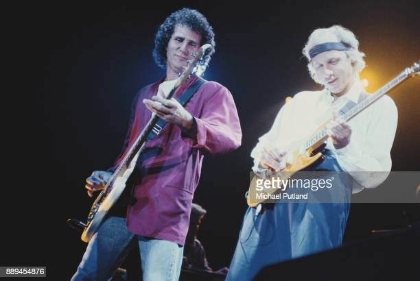 Musicians John Illsley and Mark Knopfler of the English rock band Dire Straits performing at Webley Stadium London UK 16th September 1991