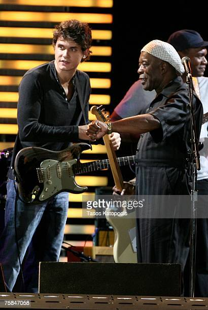 Musicians John Mayer and Buddy Guy onstage during the Crossroads Guitar Festival 2007 held at Toyota Park on July 28 2007 in Bridgeview Illinois