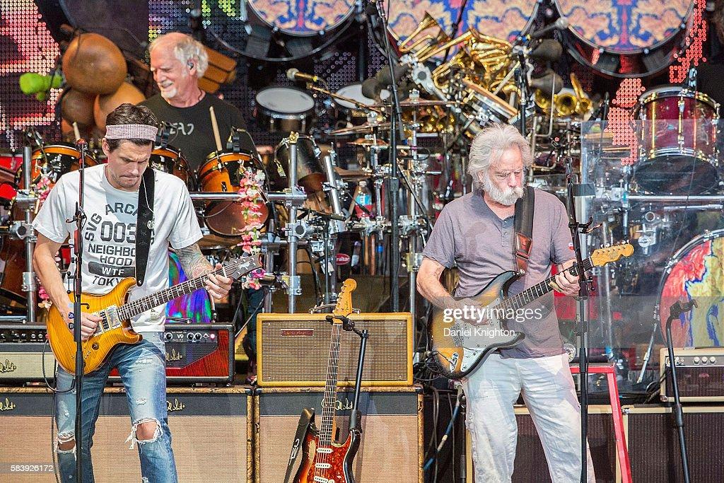 Musicians John Mayer, Bill Kreutzmann, and Bob Weir of Dead & Company perform on stage at Sleep Train Amphitheatre on July 27, 2016 in Chula Vista, California.