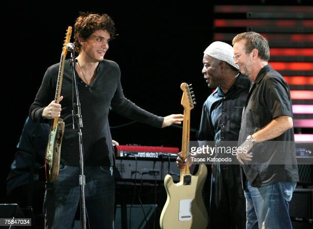 Musicians John Mayer Buddy Guy and Eric Clapton onstage during the Crossroads Guitar Festival 2007 held at Toyota Park on July 28 2007 in Bridgeview...