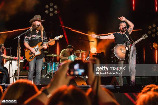 Musicians John Osborne and TJ Osborne of Brothers Osborne perform at Nissan Stadium during day 4 of the 2017 CMA Music Festival on June 11 2017 in...