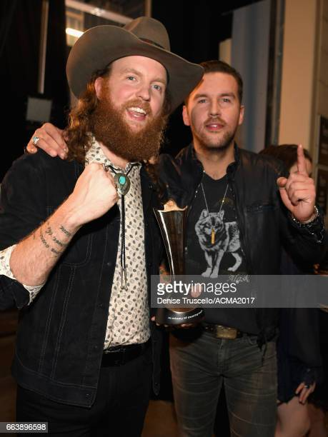 Musicians John Osborne and TJ Osborne of the music group Brothers Osborne pose with their award for Vocal Duo of the Year during the 52nd Academy Of...