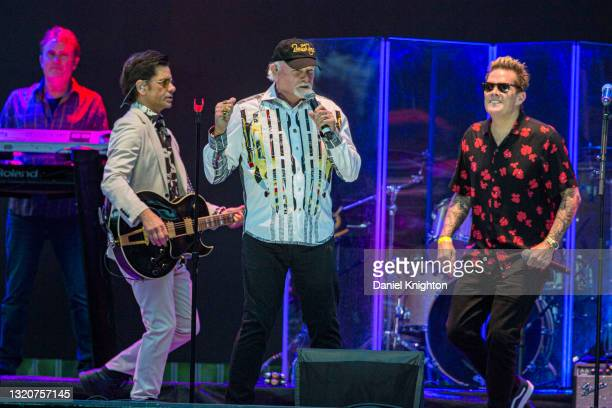 Musicians John Stamos, Mike Love, and Mark McGrath of The Beach Boys perform on stage at PETCO Park on May 29, 2021 in San Diego, California.