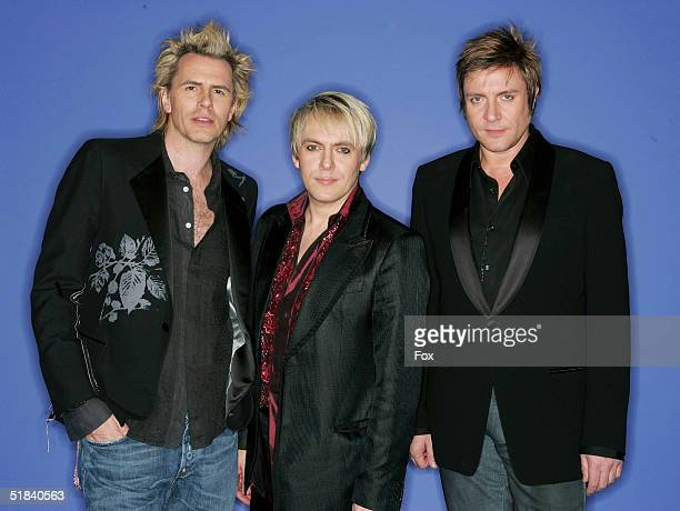 Musicians John Taylor Nick Rhodes and Simon Le Bon of Duran Duran pose for a portrait during the 2004 Billboard Music Awards at the MGM Grand Garden...