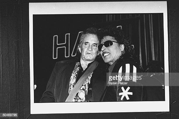 Musicians Johnny Cash w. Little Richard chatting at seventh annual Rock & Roll Hall of Fame.